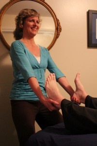 Anne massage holding lindas feet smiling 2013